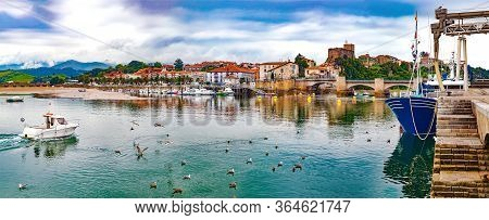 Scenic Medieval Village ,mountain And Sea Panoramic Landscape In Northern Spain.green Meadows And Bo