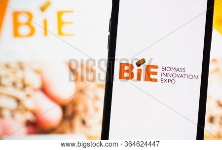 Biomass Innovation Expo Logo On A Smartphone Screen, On A Colored Background.
