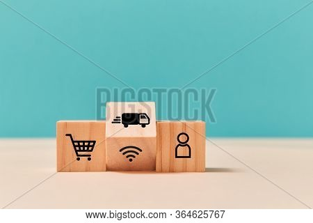 Online Supermarket And Delivery Service. Online Shopping. E-store, E-commerce. Wooden Cubes, Trolley