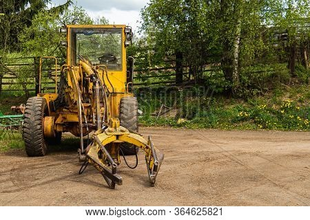 Old Digger Used To Move And Load Manure In Agriculture. Good For Background. Czech Republic