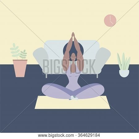 A Black Woman Meditates. A Black Woman Meditates In The Lotus Position. Yoga Classes At Home. Mainta