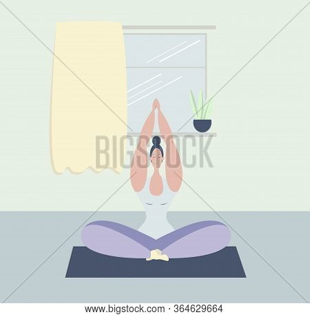 A Woman Meditates. A Young Girl Meditates In The Lotus Position. Yoga Classes At Home. Maintaining P