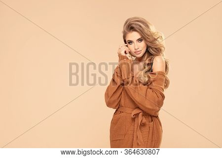 Fashionable Blonde Woman In Sweater.