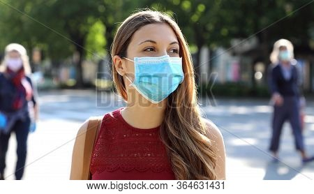 Covid-19 Social Distancing Woman In City Street Wearing Surgical Mask Against Disease Virus Sars-cov