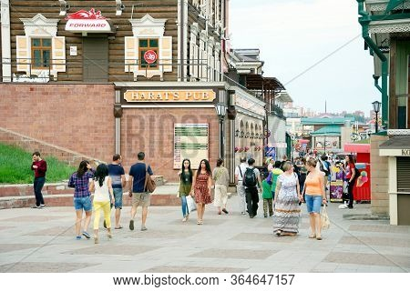 IRKUTSK, RUSSIA - 04 JULY, 2016: Street scene with typical Russian log cabins located in the center of Irkutsk, Siberia, Russia