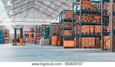 concrete storage warehouse with pallets and shelves full of goods. logistics, manufacturing, shipping and service industries. Nobody around. Horizontal format. 3d render image