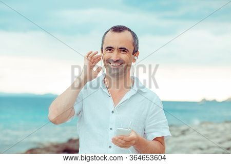 Man Listening To Music. Close Up Portrait Smiling Man Guy Listening To Music Looking At You Camera B