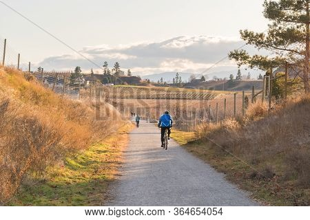 Penticton, British Columbia/canada - November 24, 2019: People Cycle And Walk Along The Kettle Valle