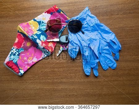 Handmade Cloth Face Mask In Pink, Red, Yellow, And Blue Floral Pattern With Keys, Sunglasses, And Di