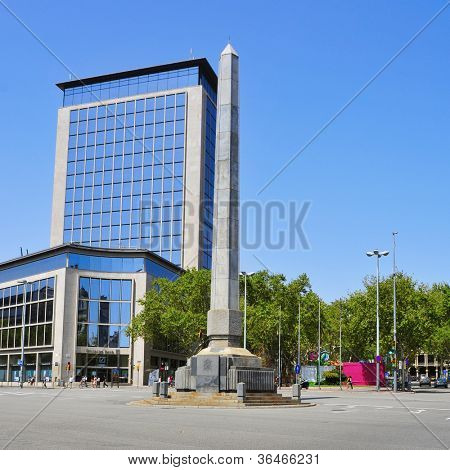 BARCELONA, SPAIN - AUGUST 17: Joan Carles I Square on August 17, 2012 in Barcelona, Spain. This square with an obelisk known as El Llapis is the intersection of famous Passeig de Gracia and Diagonal