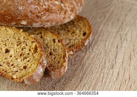 Natural Background.beautiful Slices Of Cereal Bread On A Wooden Surface.top View On Slices Of Bread.