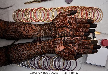 Woman Hand With Black Henna Tattoo On Jewelry, Indian Bride Girl Hand With Black Mehndi Tattoo