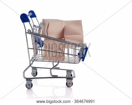 Pushcart With Boxes Isolated On White Background. The Concept Of An Online Store, Online Sale, Deliv