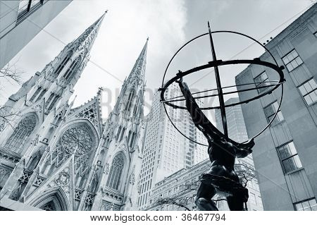 NEW YORK CITY, NY - DEC 30: Atlas statue and St. Patrick's Cathedral on December 30, 2011 in New York City. Fifth Avenue has the world's most expensive retail spaces as the symbol of wealthy New York.