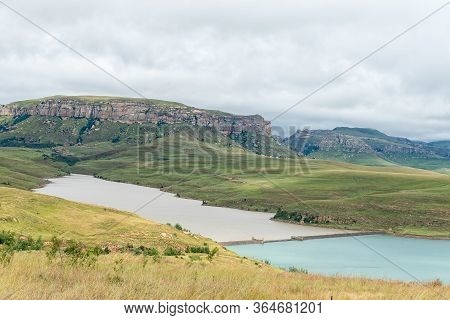 The Dam Wall Of The Driekloof Dam Separates Its Murky Water From That Of The Sterkfontein Dam