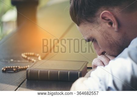 Pray And Bible Concept.caucasian Men Praying,hope For Peace And Free From Coronavirus,hand In Hand T