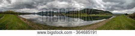 Reflection Of Dark Clouds In Lake. Panoramic Landscape. Water Reservoir Liptovska Mara And Village V