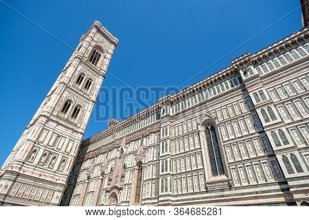 Florence, Italy - August 1, 2019: Facade of Florence Baptistery at piazza San Giovanni at sunny summer day