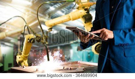 Manager Or Industrial Engineer Working And Control Robotic With Industry Factory And Network Connect