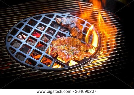 Grilling Marinated Meat On A Charcoal Grill. Grilled Steak On The Grill, Close-up. Summer Garden Par