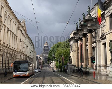 Brussels, Belgium, May 2, 2020 - A bus, public transport in front of the The Royal Museum of Belgium during the confinement period. The Palais de Justice (Law Court of Bruxelles) on background