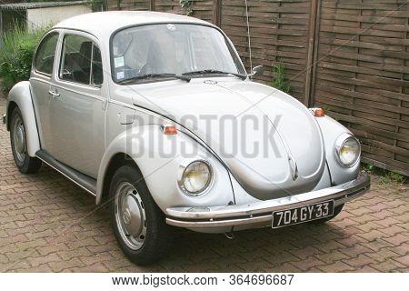 Bordeaux , Aquitaine / France - 11 18 2019 : Volkswagen Beetle Grey Classic Vw Vintage Oldtimer Park