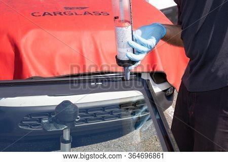 Bordeaux , Aquitaine / France - 04 26 2020 : Carglass Mechanics Man Changing Broken Sticks Windshiel