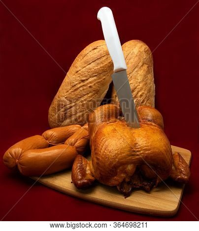 Smoked Chicken, Whole With A Golden Crispy Crust. Sausages Are Natural, Homemade, Thick And Deliciou