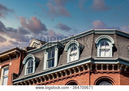 Mansard Roof On An Old Brick Building In Portland, Maine