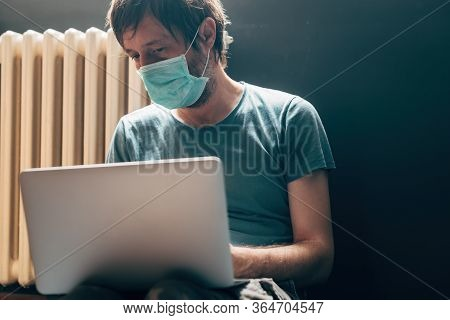 Man Using Laptop Computer In Self-isolation Quarantine At Home During Virus Outbreak Pandemic