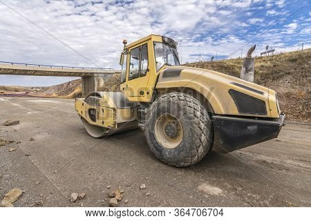 A Steamroller At The Construction Works Of A New Road