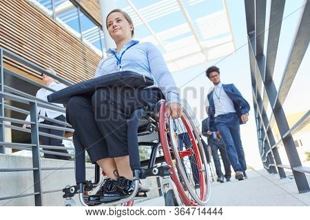Disabled woman as a wheelchair user on a ramp for inclusion and accessibility