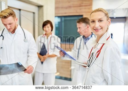 Competent young female doctor together with her team in the hospital