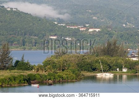 The Morning View Of Partially Sunken Sailboat And A Thick Smoke In A Background In Montego Bay Resor