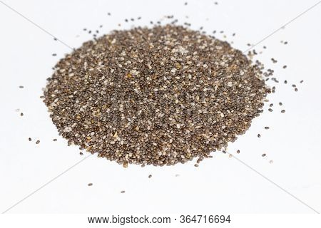 Chia Seeds Close-up Background Macro. The Texture Of The Chia Seeds. Chia Seeds On A White Backgroun