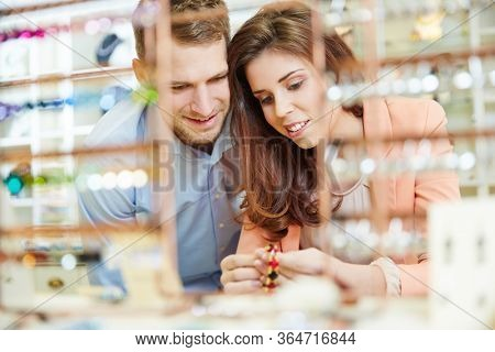 Couple at the jewelry store buys bracelet and other jewelry