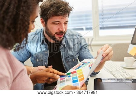 Graphic design team in the selection of colors for the design of a website
