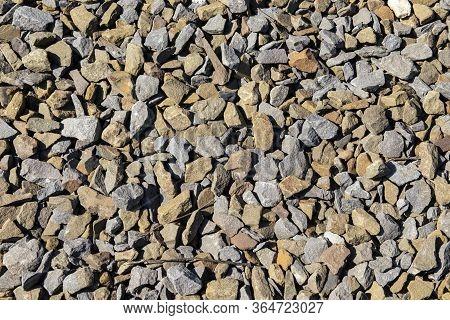 View From Above. Background Natural Gray Granite Crushed Stone, Macadam. Macro Photo Of Texture Of B