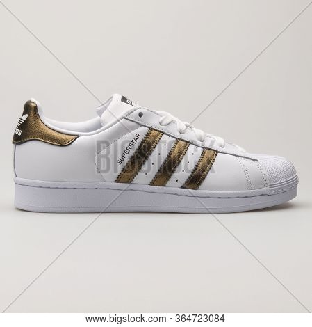 Vienna, Austria - May 27, 2018: Adidas Superstar White And Gold Sneaker On White Background.