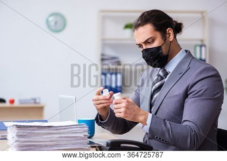 Young male employee in self-quarantine concept