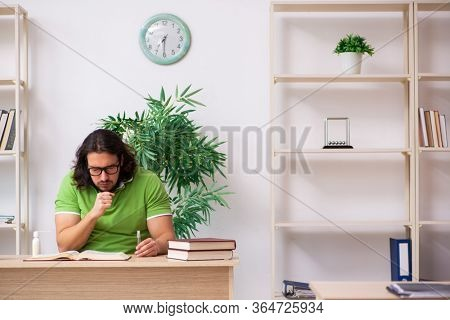 Young man student studying at home in self-isolation concept