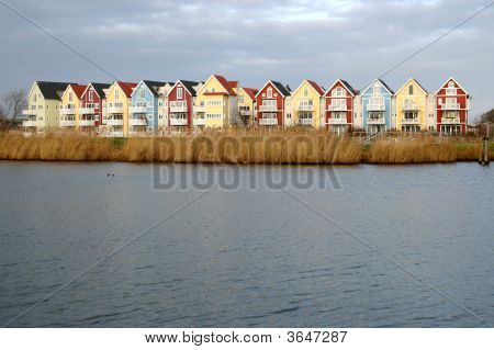 Colorful Houses Beside A River (Swedish Style)