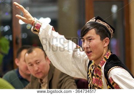 Beijing / China - April 10th 2016: Man Dances Traditional Uighur Dance Inside An Uighur Restaurant I