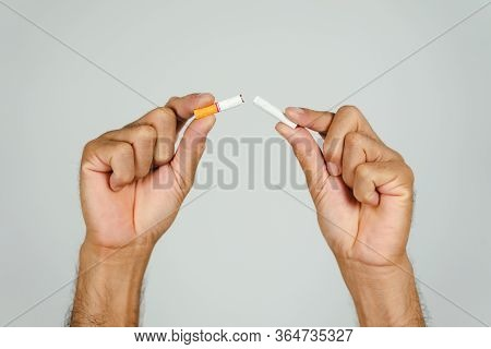 Man Hand Crushing Cigarette, Concept Quitting Smoking,world No Tobacco Day.
