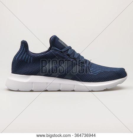 Vienna, Austria - May 27, 2018: Adidas Swift Run Navy Blue And White Sneaker On White Background.