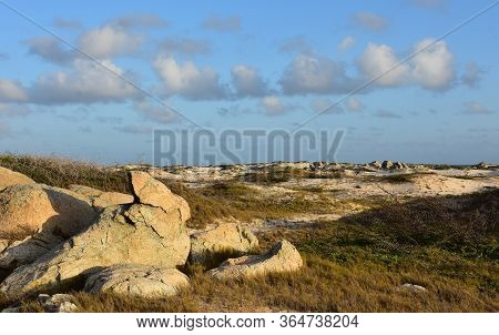 Aruba's Windswept And Sunny Rugged Landscape With Sand Dunes.