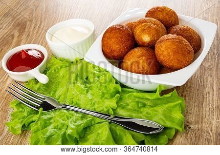 Fork On Leaves Of Lettuce, Sauceboat With Ketchup, Bowl With Mayonnaise, Bowl With Small Round Fried
