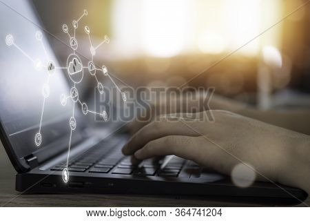 Virtual Cloud And Icon With Hand Use Laptop To Download And Upload Technology Information. Technolog