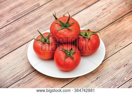 Raw Ripe Pink Heirloom Organic Tomatoes On Wooden Background. Vegetarian - Vegan Healthy Diet Culina