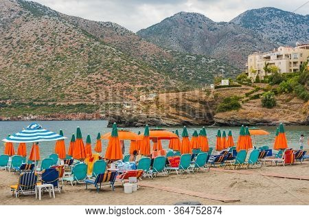 Bali, Crete, Greece - October 7, 2019: Spectacular View Of The Beach With Colorful Umbrellas And Sun